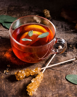High angle tea with lemon slices and crystallized sugar canes