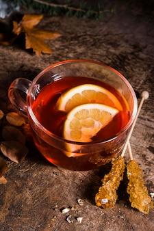 High angle tea with lemon slices and crystallized sugar