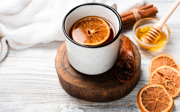 High angle of tea with orange and honey