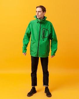 High angle teenager with green jacket