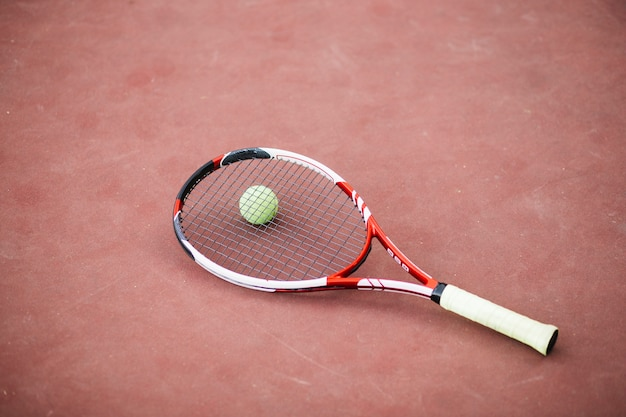 High angle tennies field with ball and racket