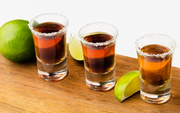 High angle tequila shots with lime slices