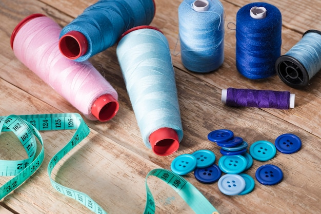 High angle of thread reels with buttons and measuring tape