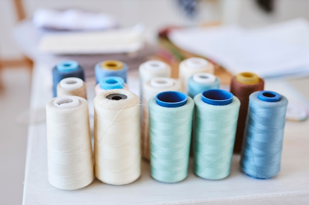 High angle of thread spools in fashion atelier