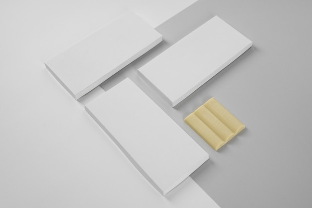 High angle of three white chocolate tablets packaging with copy space