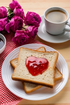 High angle of toast with jam and coffee
