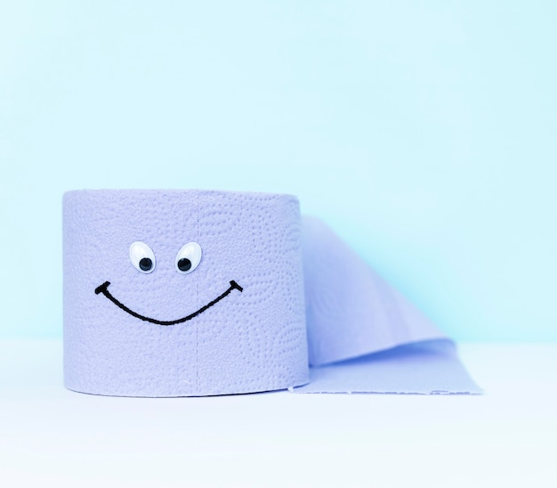 High angle toilet paper roll with eyes and smiley