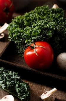 High angle tomato and kale salad