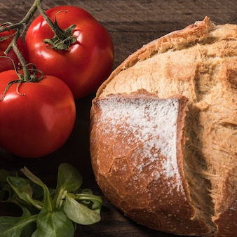 High angle tomatoes and bread arrangement