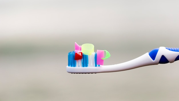 High angle toothbrush with plastic pieces