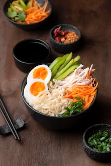 High angle of traditional asian noodles with eggs and vegetables