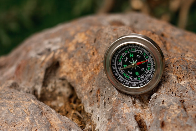 High angle traveler compass on rocks