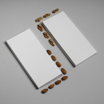 High angle of two blank chocolate bars packages with nuts