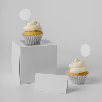 High angle of two cupcakes with packaging box