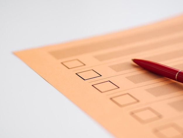 High angle uncompleted voting questionnaire close-up