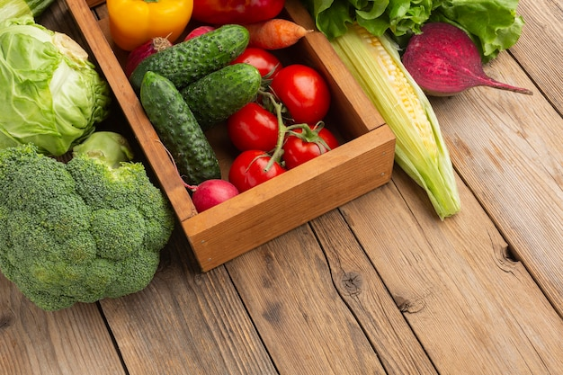 High angle vegetables on wooden table