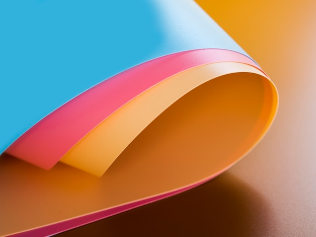 High angle of vibrant colorful bent paper sheets