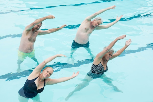 High angle view of active seniors exercising in swimming pool