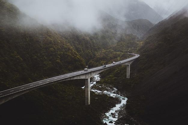 High angle view of the arthur's pass, new zealand covered by the fog on a gloomy day