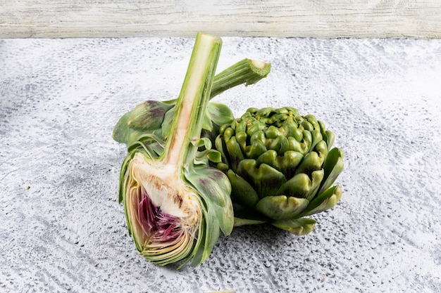 High angle view artichokes and a slice . horizontal