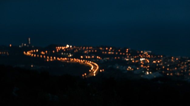 High angle view of blurred countryside light over the mountain