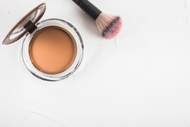 High angle view of blusher with brush on white background