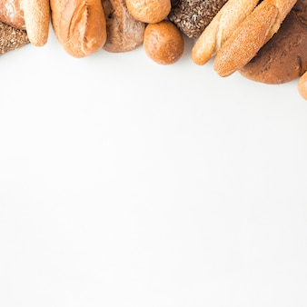 High angle view of breads at the top of white background