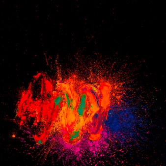 High angle view of bright holi colored in front of black background