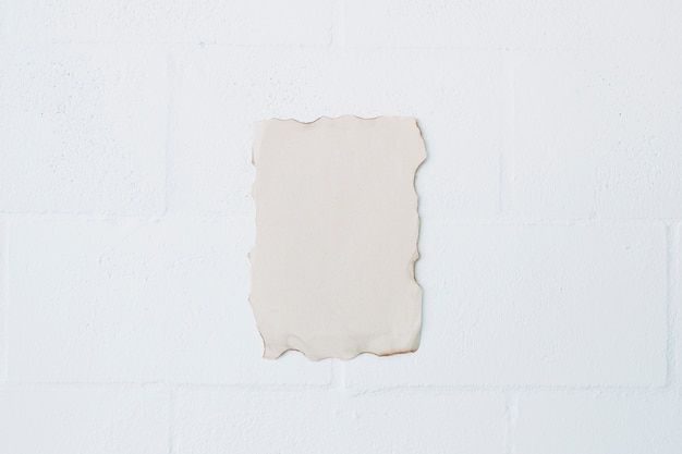 High angle view of burnt paper over white wall