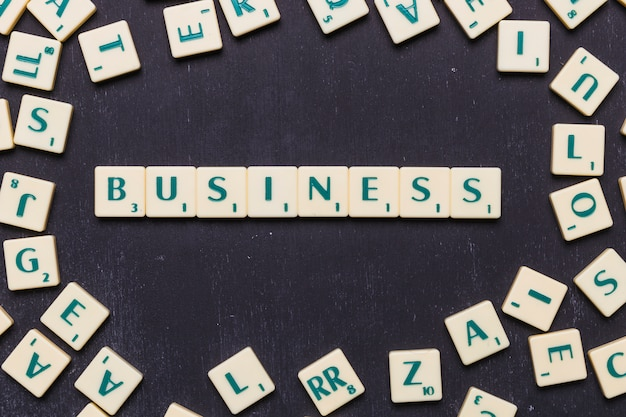 High angle view of business text on scrabble letters