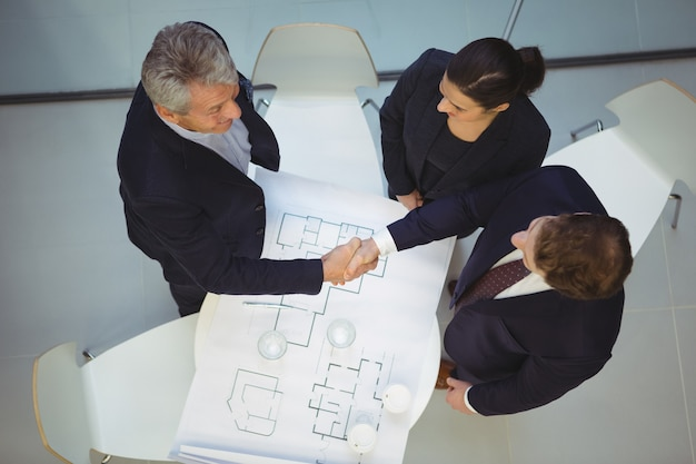 High angle view of businesspeople shaking hands