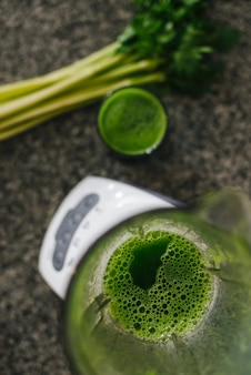 High angle view of celery smoothie in blender