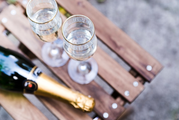 High angle view of champagne glass on wooden table