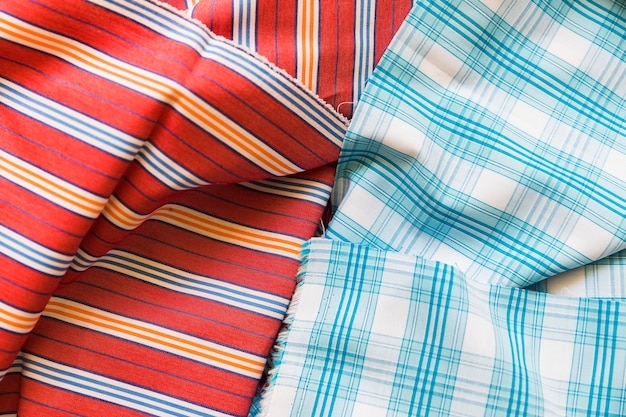 High angle view of chequered and stripes pattern fabric background
