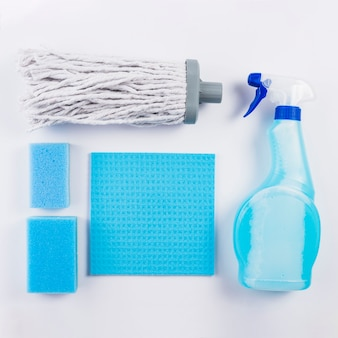 High angle view of cleaning equipments on grey background