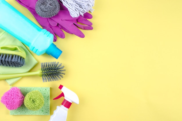 High angle view of cleaning products on yellow background