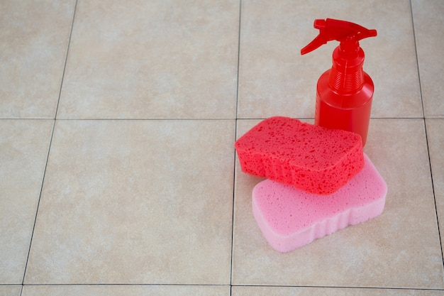 High angle view of cleaning sponge with spray bottle