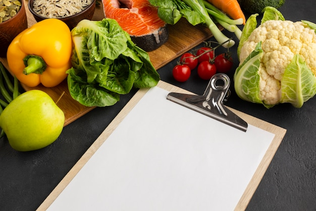 High angle view clipboard with vegetables