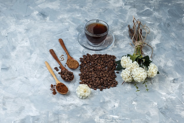 High angle view coffee beans, cup of coffee with coffee beans, instant coffee, coffee flour