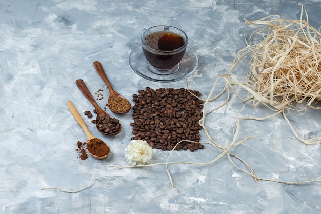 High angle view coffee beans, cup of coffee with coffee beans, instant coffee