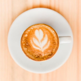 High angle view of coffee latte on wooden table