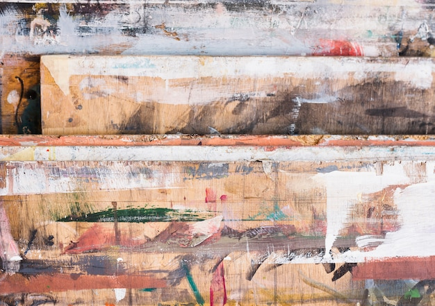 High angle view of colorful brushstroke on wooden textured