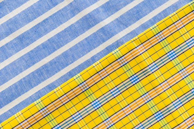 High angle view of colorful chequered and line pattern textiles