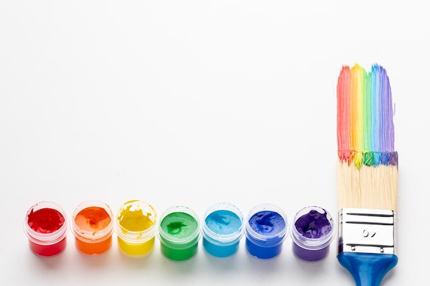 High angle view of colorful paint and brush