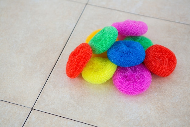 High angle view of colorful sponges on floor