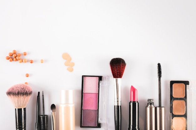 High angle view of cosmetic beauty products on white backdrop