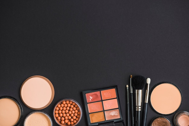 High angle view of cosmetic products on black surface