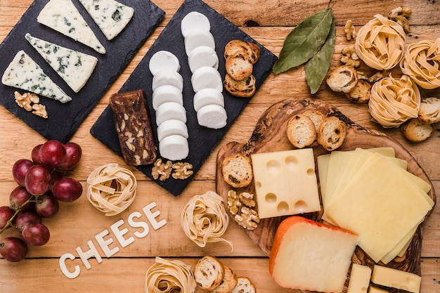 High angle view of delicious fresh food with cheese text on wooden surface