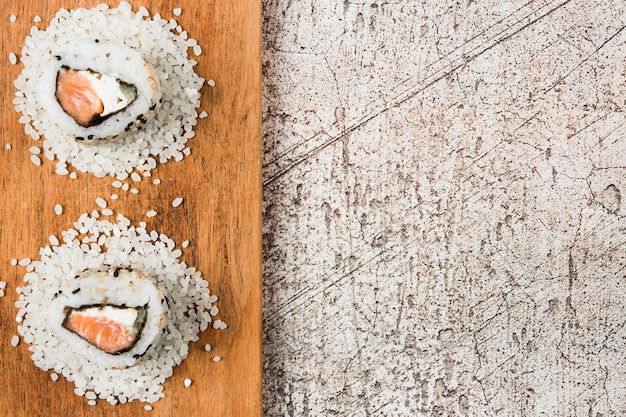 High angle view of delicious sushi on wooden tray