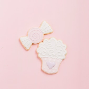High angle view of dessert cookies on pink background